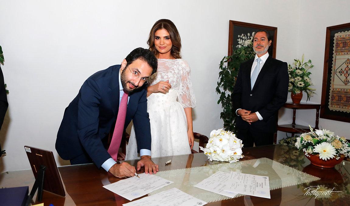 Happy young Groom signing wedding registration form in Municipality of Yermasoyia | professional photography wedding photo in Yermasoyia, Yermasoyia wedding photography packages cyprus
