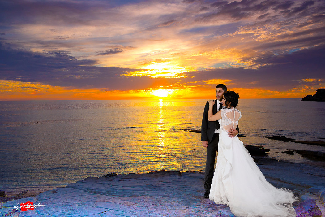 Young couple holding hands at Paphos beach sunset | wedding photography paphos, cyprus sunset images paphos wedding photography