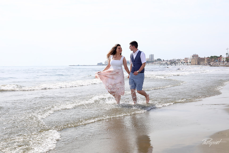 Happy just married young wedding couple celebrating and have fun by the beautiful beach of Lanaca