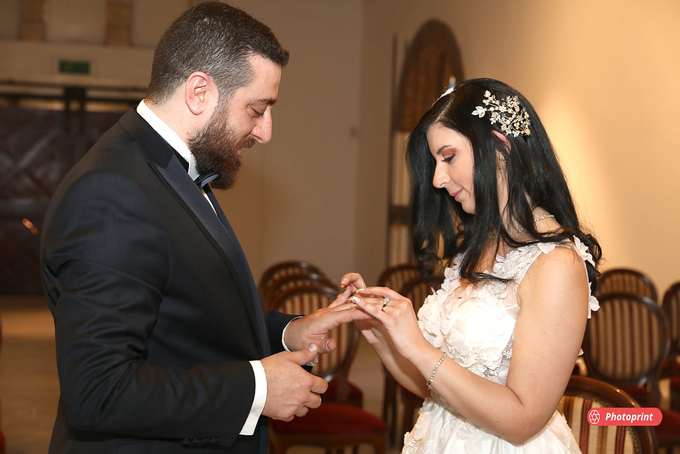 Beautiful and gentle wedding ceremony photo session indoors of the elegant couple.