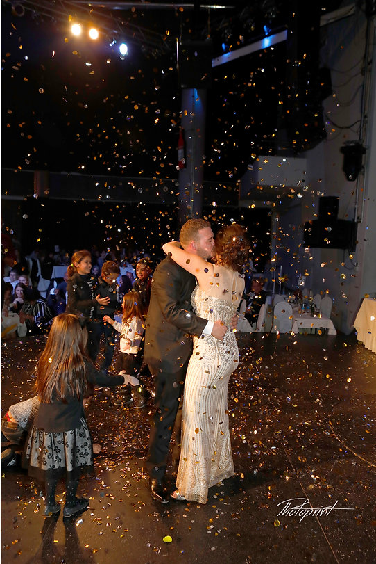 Portrait of confetti flying at dancing beautiful bride and groom  |  icosia wedding photographer packages and pirces, nicosia photographers cyprus,  photographers nicosia cyprus,  wedding photographers nicosia nicosia cyprus, photographres cyprus nicosia.