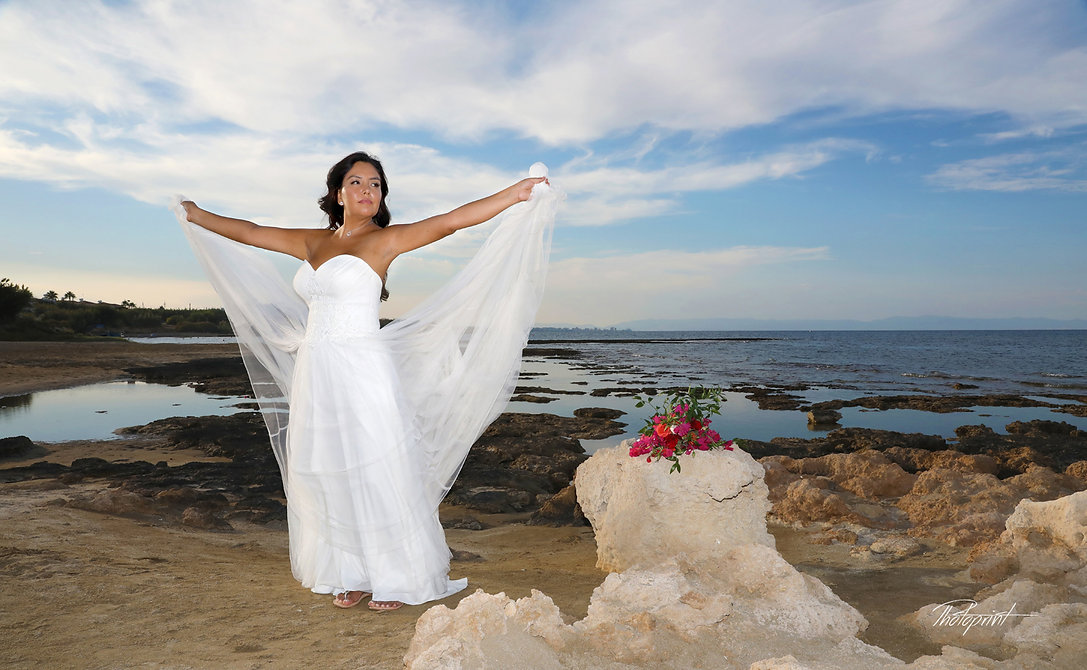 Beautiful wedding bride on Agia Triada beach at sunset | wedding photography agia triada