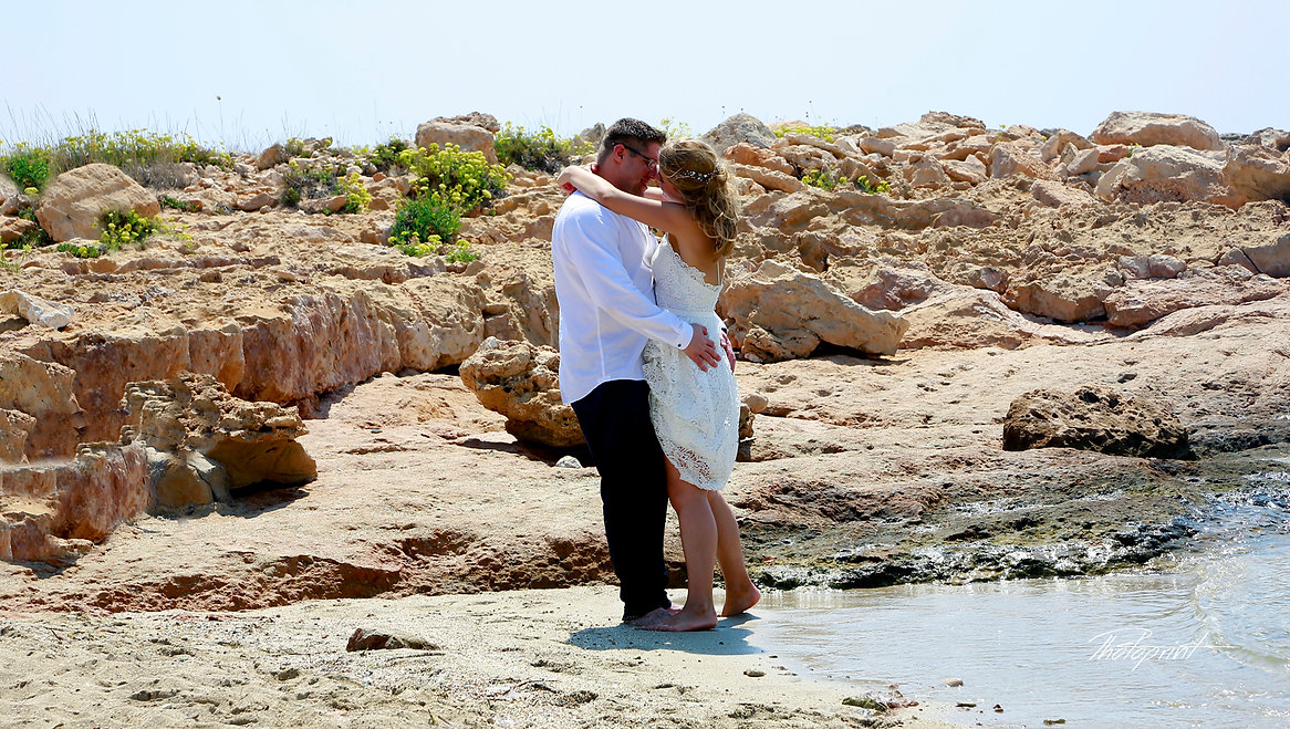 The bride and groom hugging on the shore of  blue Sea |  ayia napa cyprus wedding ceremony, ayia napa cyprus wedding hotels,ayia napa cyprus wedding photo