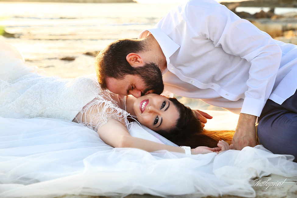 Beautiful young and attractive Couple kissing and celebrating by the beach Paphos