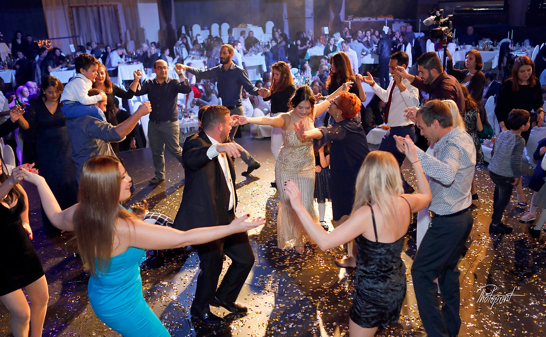 Happy friends dancing at nightclub Pavilion with bride and groom  |  civil marriage in cyprus for lebanese, getting married in cyprus town hall, wedding photographers nicosia cyprus, getting married in nicosia town hall, Beautiful Natural Wedding Photography in Nicosia,