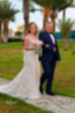 The bride coming with her father for the wedding ceremony | Beach Weddings Packages larnaca cyprus, best photographers in larnaca, Civil ceremony at Larnaka town hall