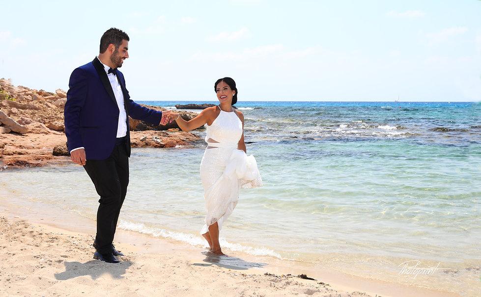 Couple on a beach at ayia napa. cyprus wedding photographer ayia napa
