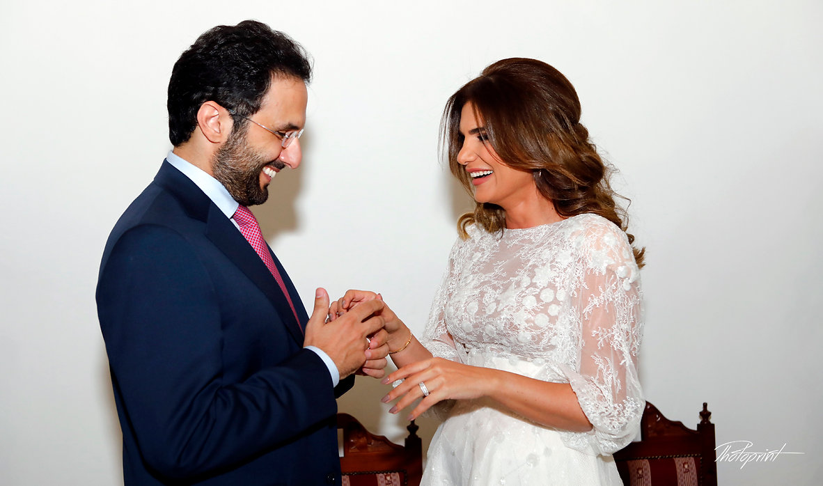 Bride putting a ring on groom's finger in Yermasoyia, Limassol | wedding photography ceremony municipality Yermasoyia, wedding photography ceremony in Yermasoyia town hall