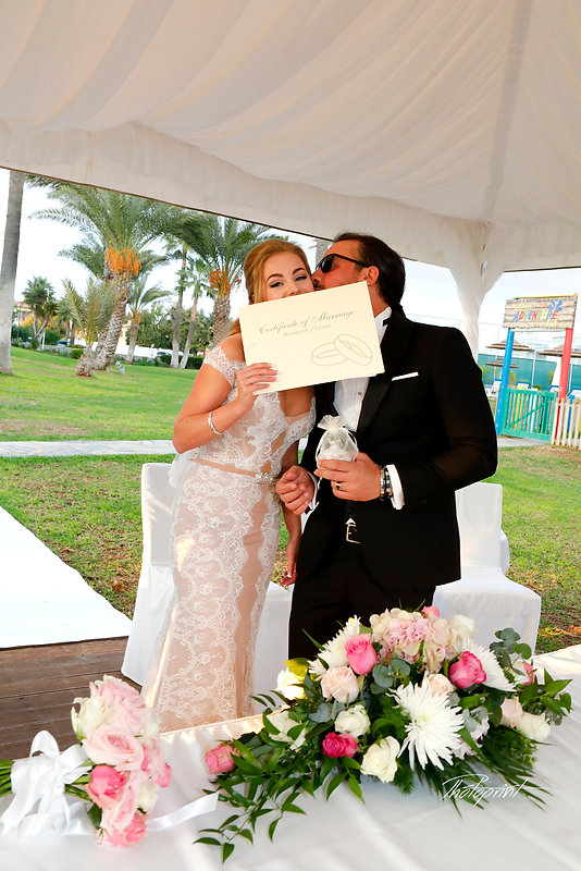 Happy couple after the wedding ceremony at Golden Bay Beach Hotel, Larnaca cyprus |  Beach wedding reception venue in Larnaca | photoprint cyprus, beach weddings larnaca, Beach Weddings Packages larnaca, Civil ceremony at Larnaca town hall