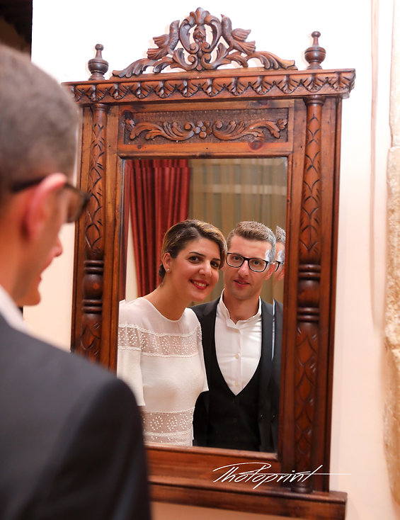 Portrait of the beautiful young bride and groom against a mirror in the reflection indoors the Larnaca municipality |  cyprus wedding larnaca photographers near, cyprus wedding photographers