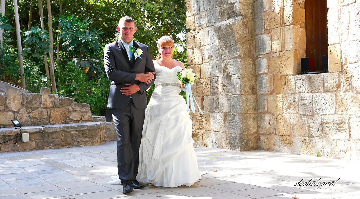 Gorgeous blonde bride and stylish groom near Ottoman Baths in Paphos | wedding paphos  photographers, cyprus dream wedding photography paphos