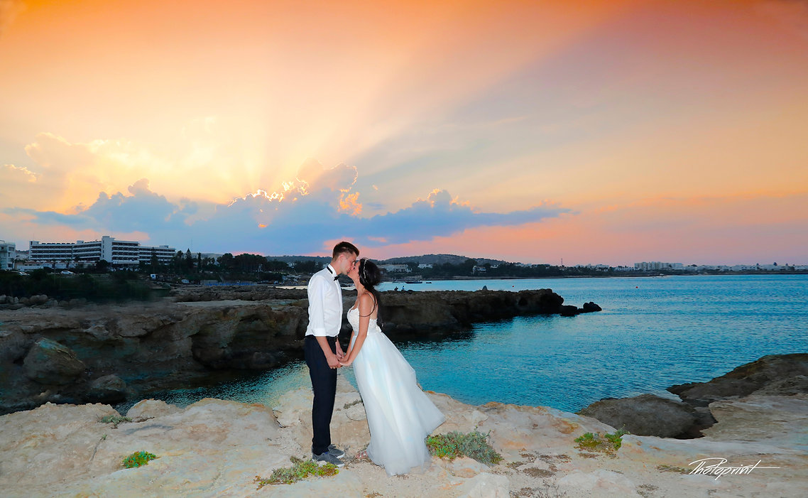 Bride and Groom, Kissing at Sunset on  Beautiful Protaras Beach, cyprus | cyprus wedding photographers prices protaras beach hotels,budget wedding photography cyprus