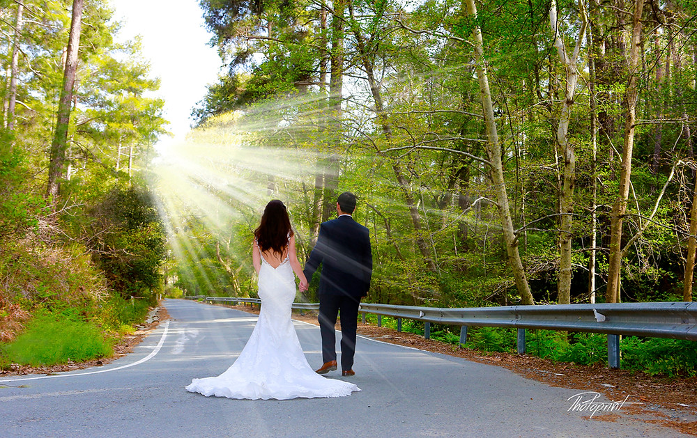 Romantic picture of the marriage couple at mountain after the wedding .
