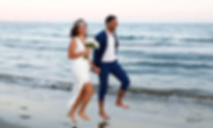 Cheerful young  wedding couple smiling jumping on the beach at sunset time | city hall larnaca wedding photography cyprus, larnaca best weddings abroad