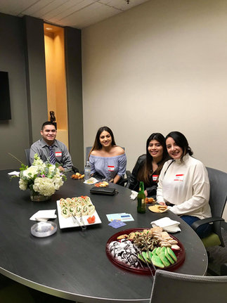 Group of people eating in the conference room