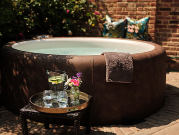 The hot tub in the walled garden at The Spa