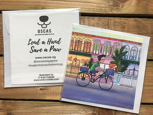 Cycling by the Shophouses Greeting Card