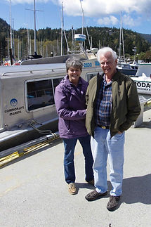 Brian and Leanne on the dock in Snug Cove next to their boats