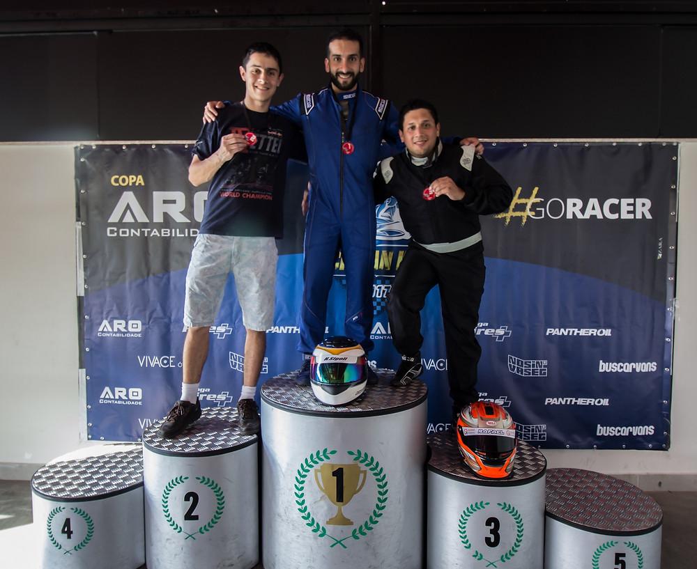 Pódio da terceira etapa: Nicolas Smith (FRT), P02; Henrique Sigoli (SAP), P01; Rafael Nascimento (WRT), P03. Paulista Kart League PKL