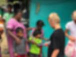 Nuwara-Eliya-villagers-giving-pencils-sr