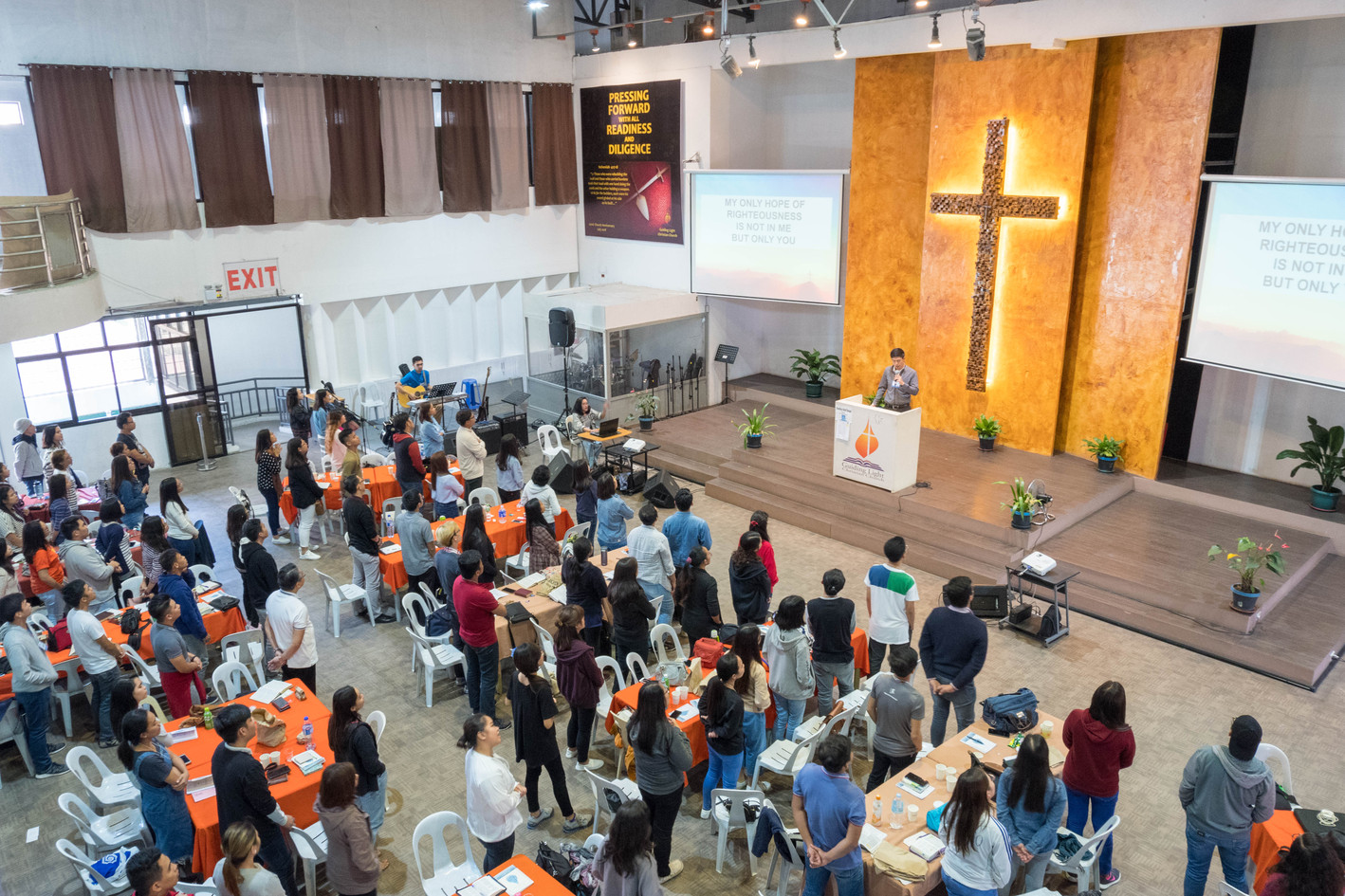 Ptr. Kito Leading Worship before the Third Plenary