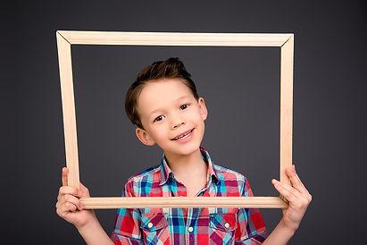 child-holding-frame.jpg