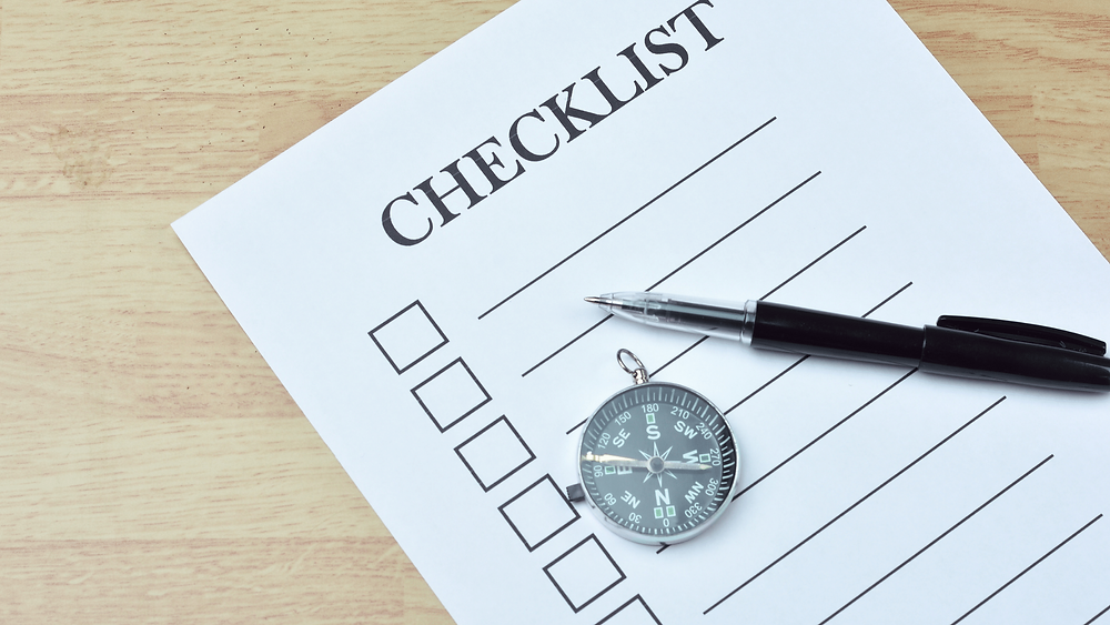 checklist, pen, and compass graphic - the power of checklists