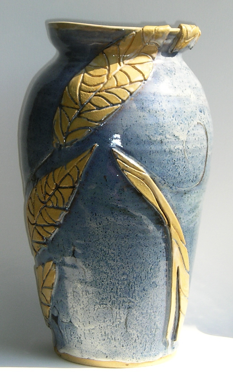 tall blue vase with leaves
