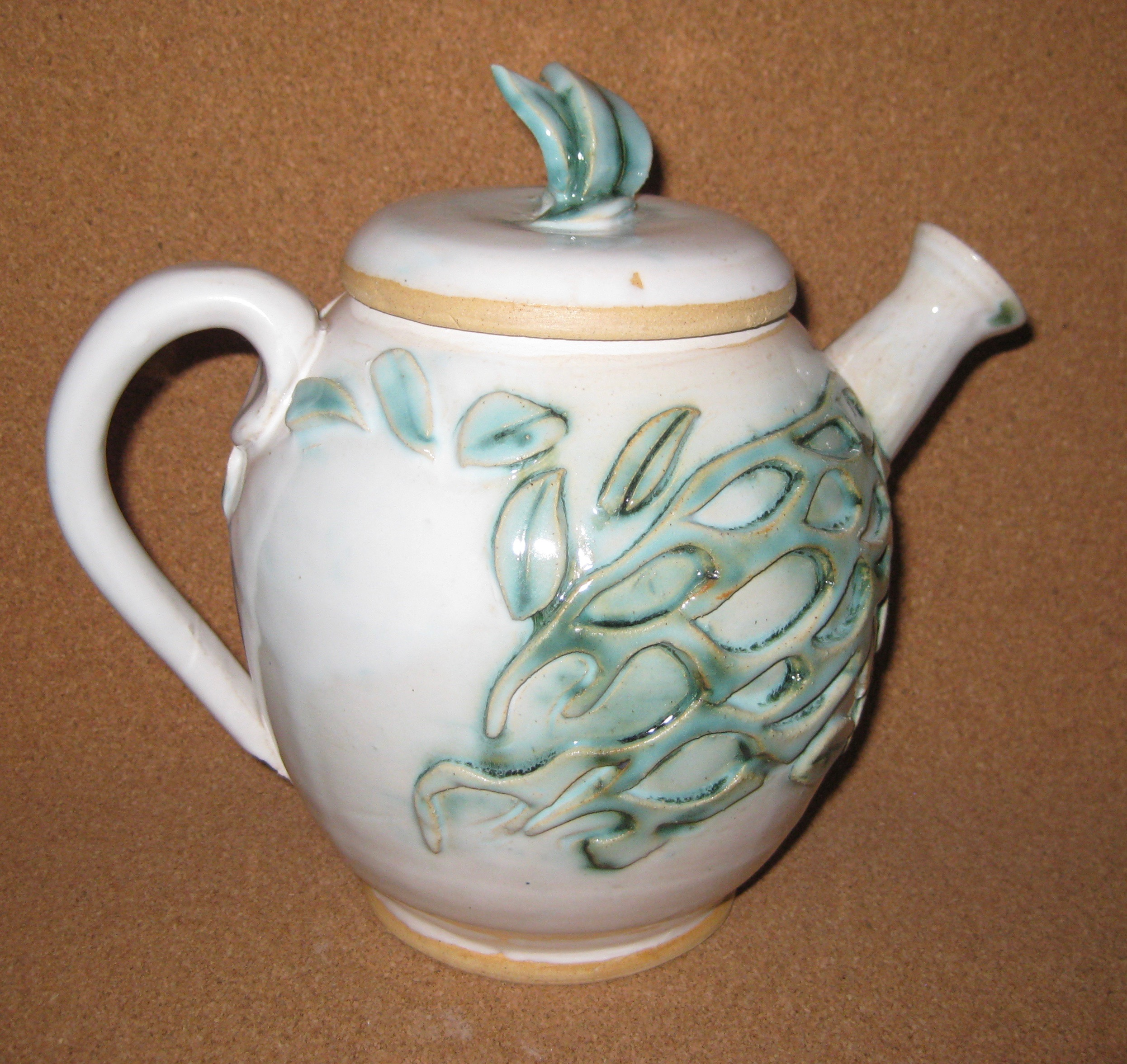 white and green teapot