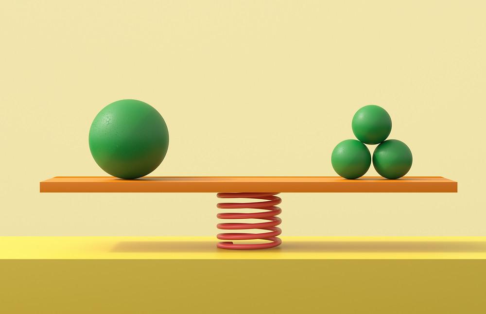 balls balanced on scale