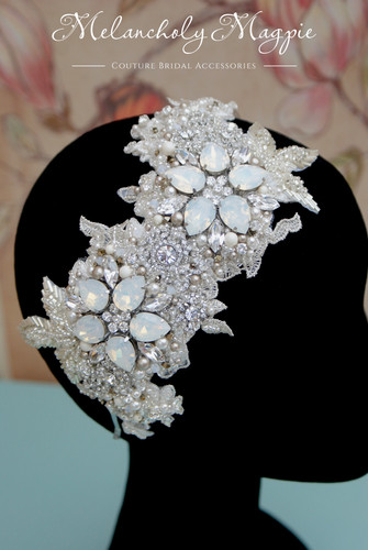 White opal monte carlo hair piece on a band