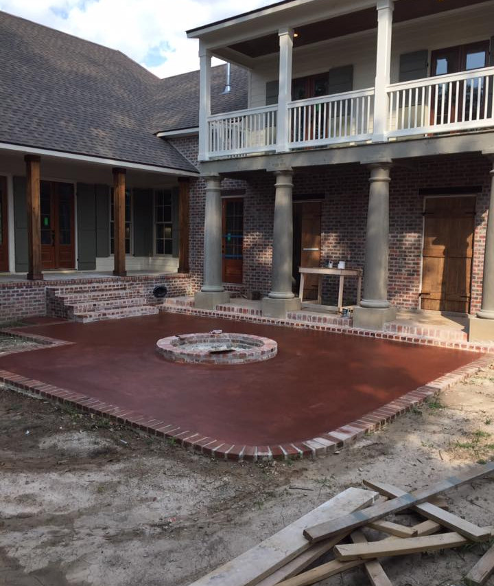 Stained Concrete Patio With Sugar Kettle Center Piece