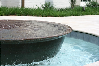 Beautiful water feature using cast iron sugar kettle