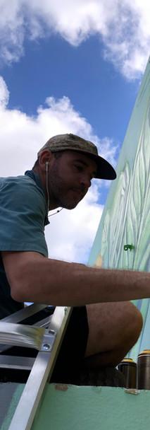 In progress shot of exterior mural for distillery in Miami, FL by DaveL. 2021.