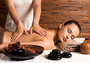 woman-with-closed-eyes-having-massage-of