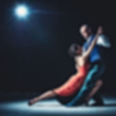 woman-and-man-dancing-under-light-218801