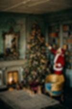 man-standing-beside-christmas-tree-31498