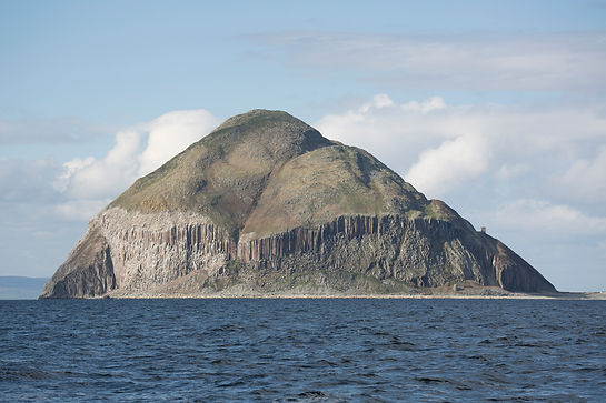 """Ailsa Craig """"Paddy's milestone""""  was a haven for Catholics during the Scottish Reformation in the 16th century. It is now a bird sanctuary. See gannets, guillimots and an increasing number of puffins."""
