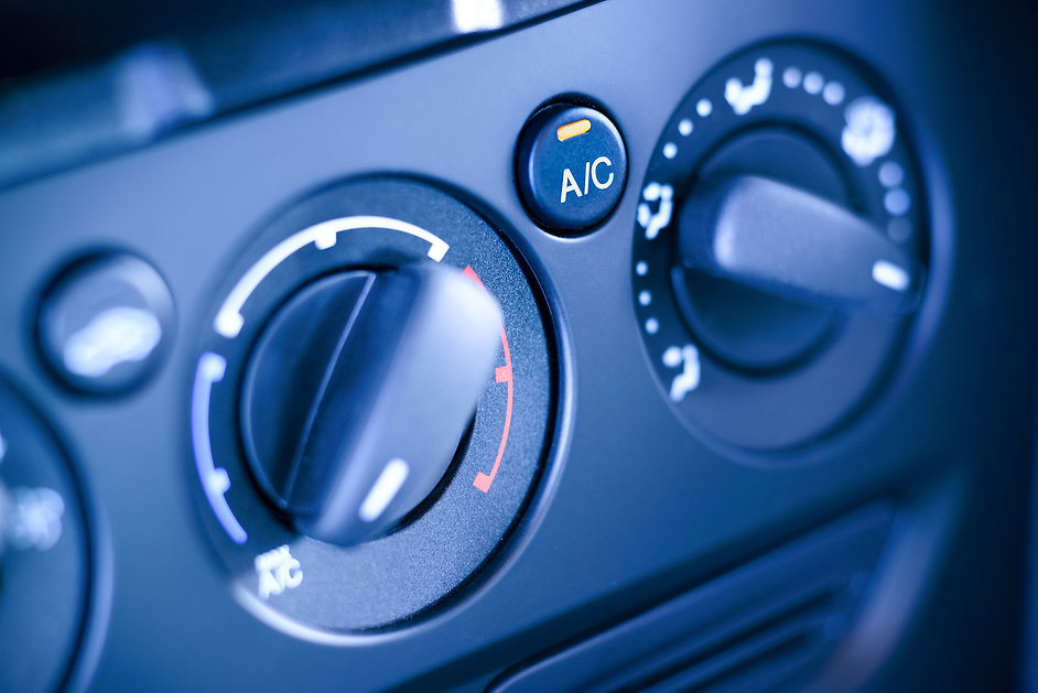 vehicle interior with visible climate controls.jpg