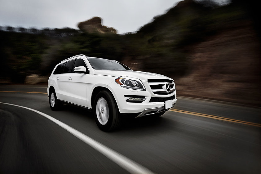White car driving fast on the road.jpg