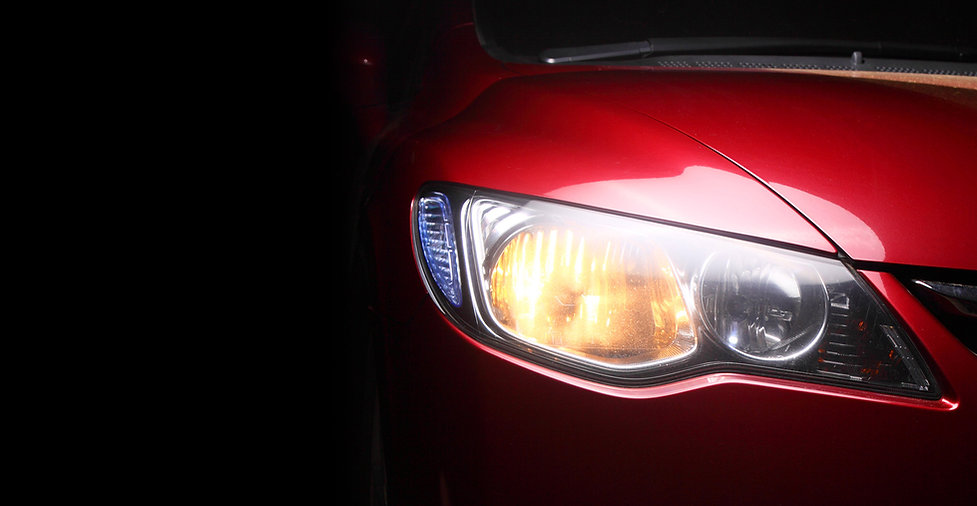 detail of a red Cars headlight.jpg