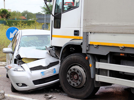 What Should I Do If a Company Truck Driver Hit My Car?