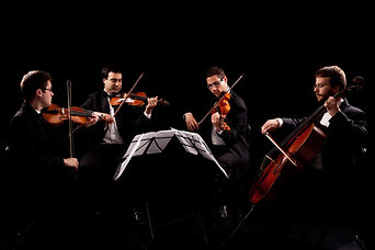 Picture of a peforming string quartet.