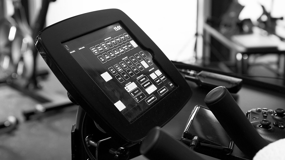 An tablet set up for fitness sound system automation control