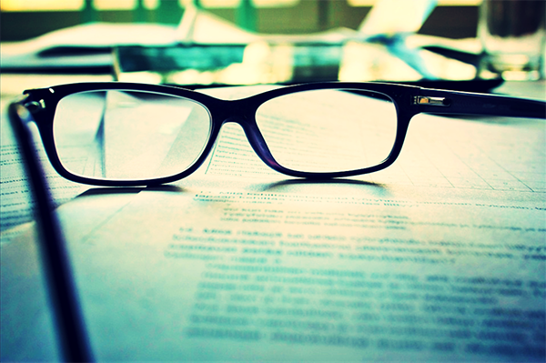 glasses on a contract