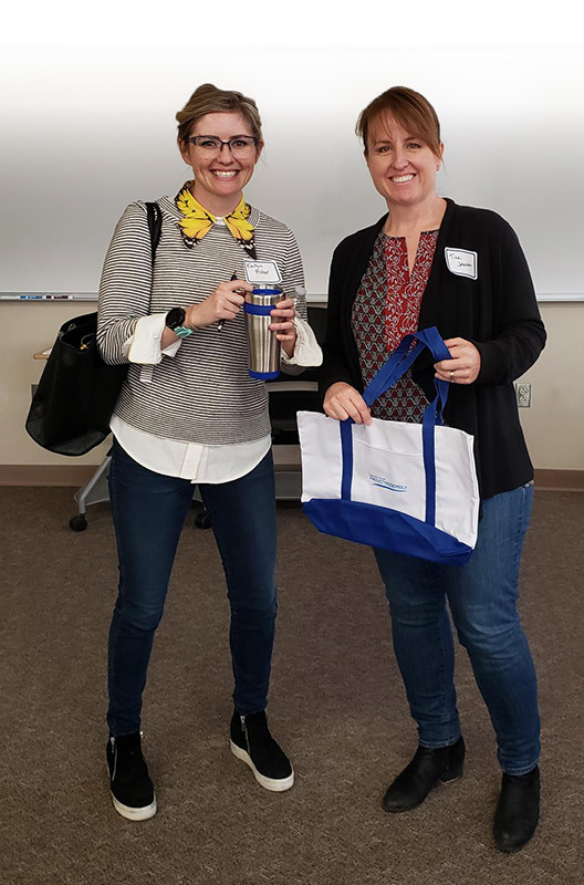 Kaitlin Fisher and Tina Johnson with prizes