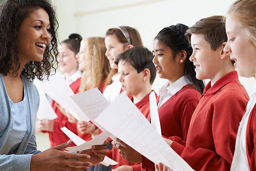 Children In School Choir Being Encourage