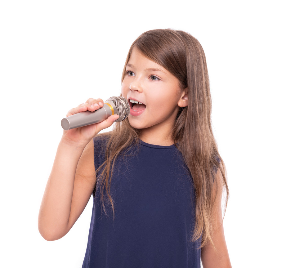 Little girl posing with a microphone for