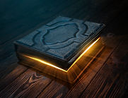 Old magic book on wooden table with ligh