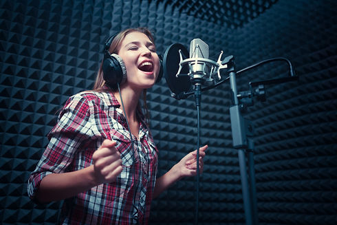 Singing woman in a recording studio.jpg